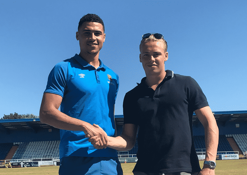 Courtney Duffus with Waterford FC General Manager Jack Power.