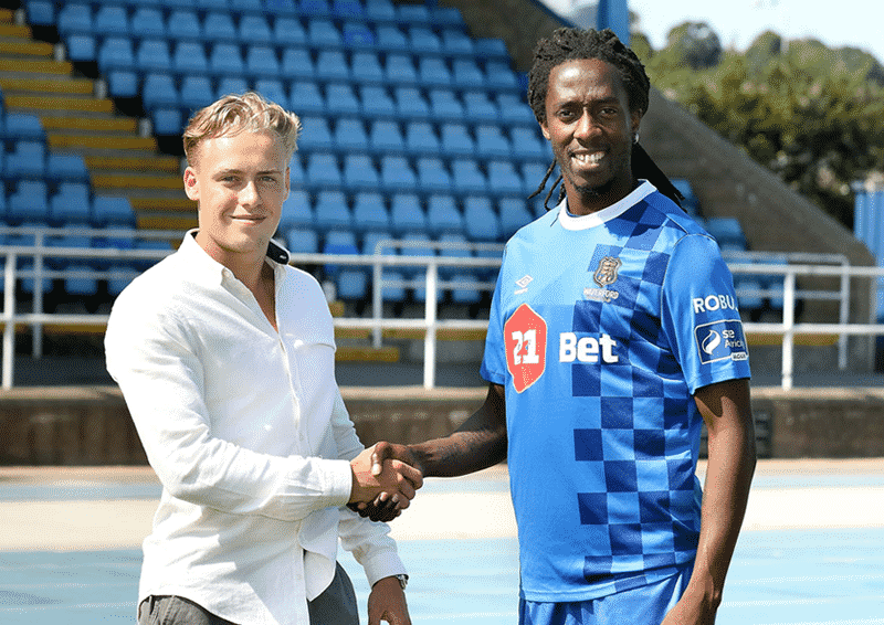 New signing Carlos Wilson with General Manager Jack Power. Credit: Noel Browne